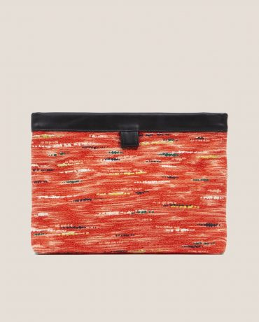 Clutch de Petty Things con piel color negro con tela vintage barkcloth Ginger-delantera