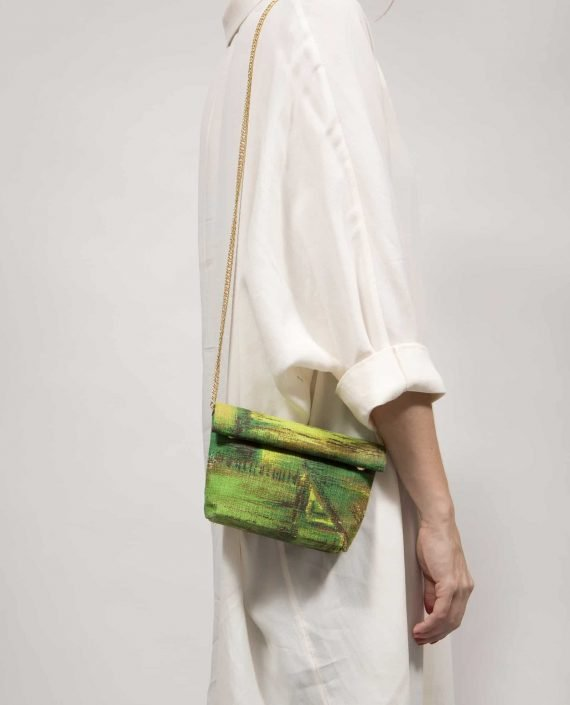 Small bag hanging from shoulder human model, made of vintage fabric barkcloth Peter by Petty Things