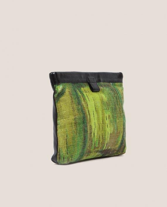 Clutch de Petty Things con piel color negro con tela vintage barkcloth dry brush-lateral